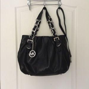 Like new Micheal Kors black leather bag